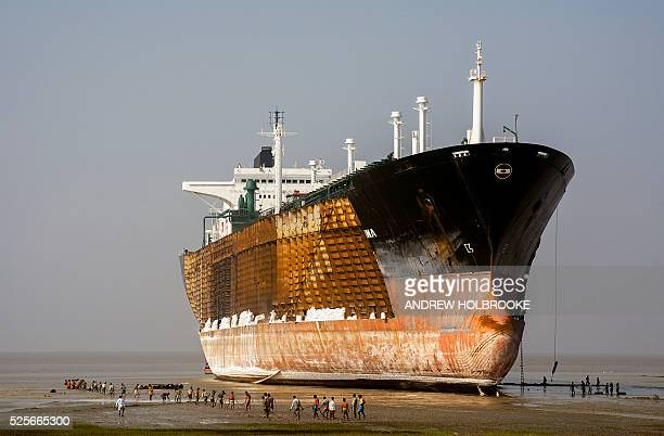 Workers in the ship breaking industry dismantle oil tankers by hand in the yards on the beach in Chittagong This important industry for Bangladesh's...
