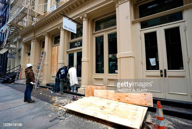 Workers in the Soho area of New York prepare their businesses by boarding up on November 2 as they make plans for potential civil unrest during the...