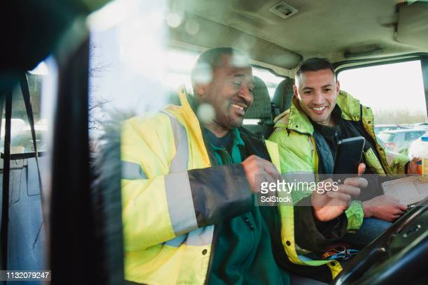 workers in their van - old truck stock pictures, royalty-free photos & images