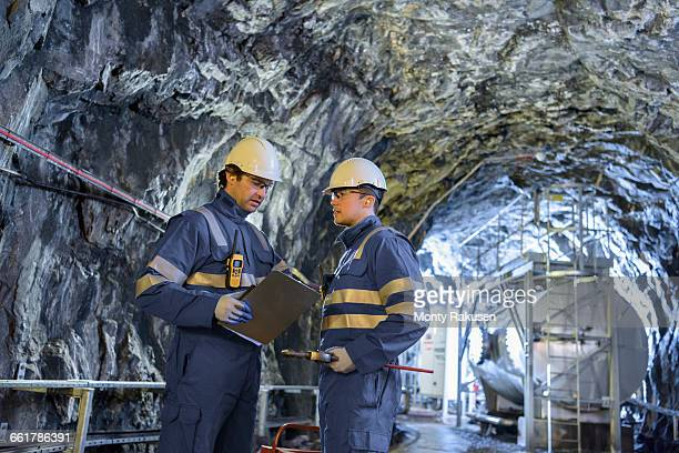 workers in tunnel in hydroelectric power station - monty rakusen stock photos and pictures