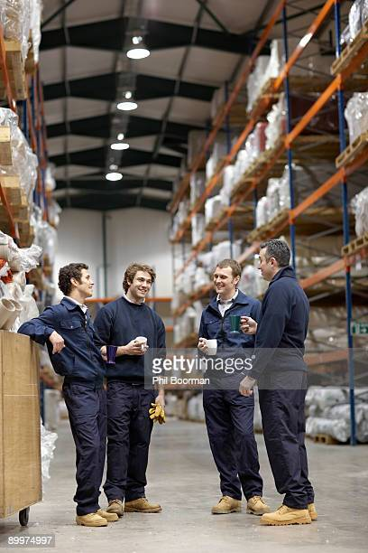 workers in warehouse having break - coffee break stock pictures, royalty-free photos & images