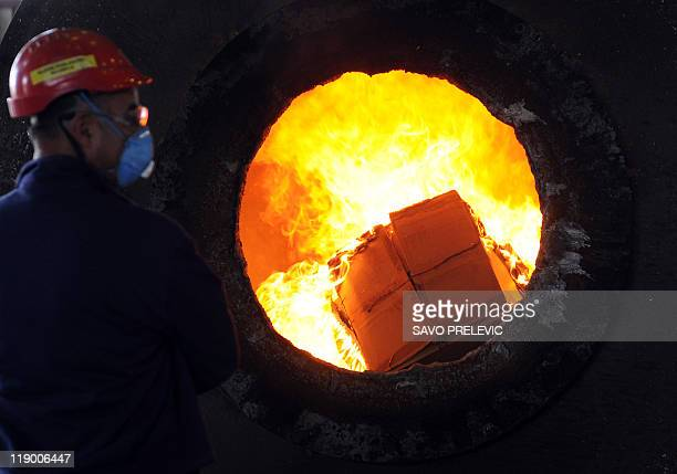 Workers incinerate drugs at an aluminum plant in the Montenegrin capital Podgorica on July 6 2011 Police in Montenegro today destroyed 266 tones of...