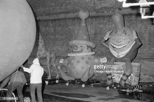 Workers inflate large balloons of characters such as Humpty Dumpty for the annual Christmas parade, Chicago, Illinois, December 7, 1973.