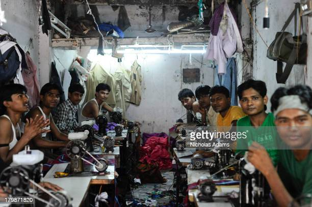 CONTENT] Workers inside a cramped sweatshop factory in Dharavi Mumbai
