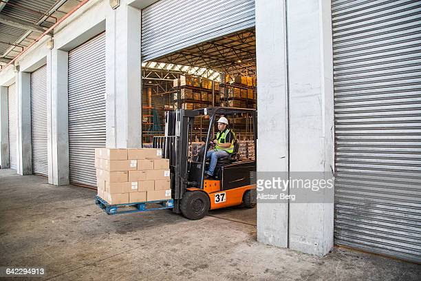 Workers inside a food distribution warehouse