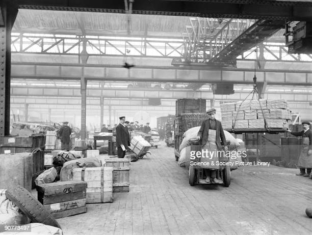 Workers inside Oldham Road goods depot which started life as a station in 1839 but after 4 years it was closed and turned into a goods depot This...