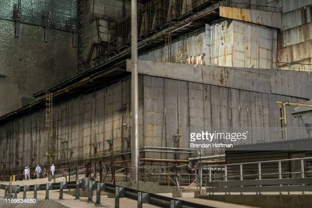 Workers inside the 'New Safe Confinement' which contains the old sarcophagus entombing the destroyed reactor number four at the Chernobyl Nuclear...
