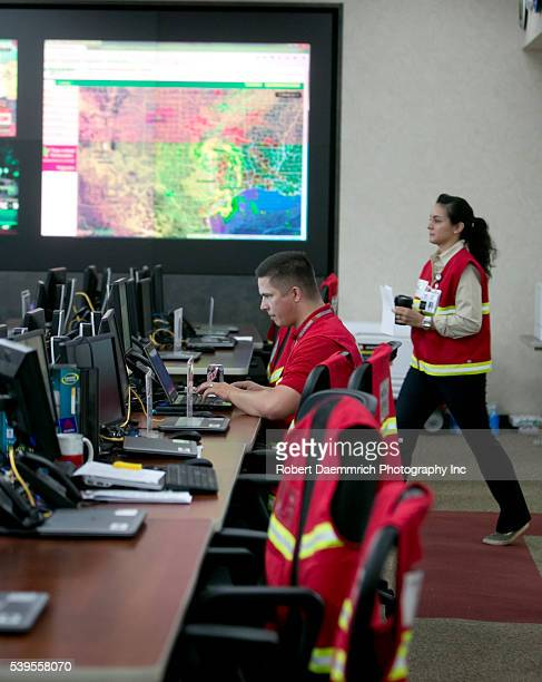 Workers inside the Texas Division of Emergency Management, State Operations Center at the Texas Department of Public Safety headquarters in Austin,...