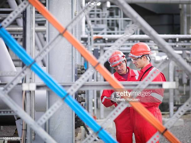 Workers inspect gas storage plant