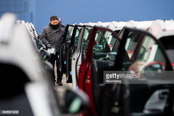 Workers inspect Kia Motors Corp vehicles bound for export at the port of Pyeongtaek in Pyeongtaek South Korea on Monday Jan 22 2018 Kia Motors is...