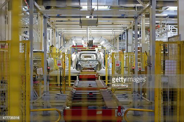 Workers inspect the body shell of a Renault Twingo at the Renault Revoz dd plant a unit of Renault SA in Novo Mesto Slovenia on Friday 19 June 2015...