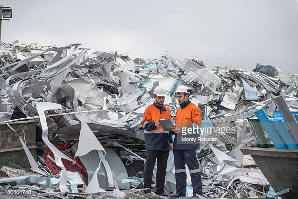 Workers inspecting scrap in aluminium recycling plant