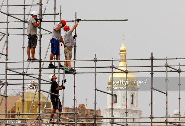 Workers install a construction for the Independence Day stage on the Independence square in Kyiv Ukraine 16 August2018 45 thousand troops and 250...