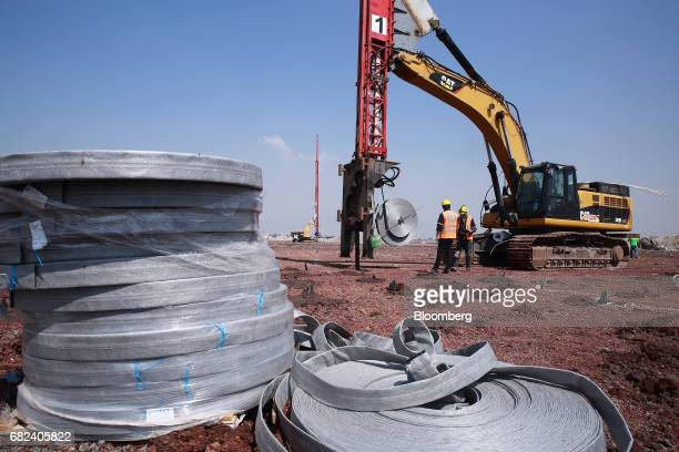 Workers install a drainage system during construction on the grounds of the New International Airport of Mexico City in Texcoco Mexico on Monday...
