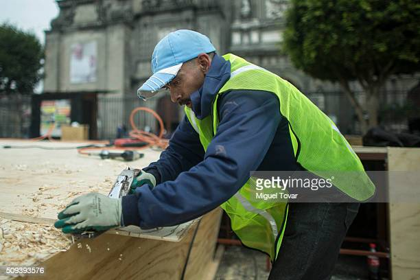 Workers install a wooden ramp at the entrance of the Catedral Metropolitana, as part of preparation ahead Pope Francis visit on February 10, 2016 in...