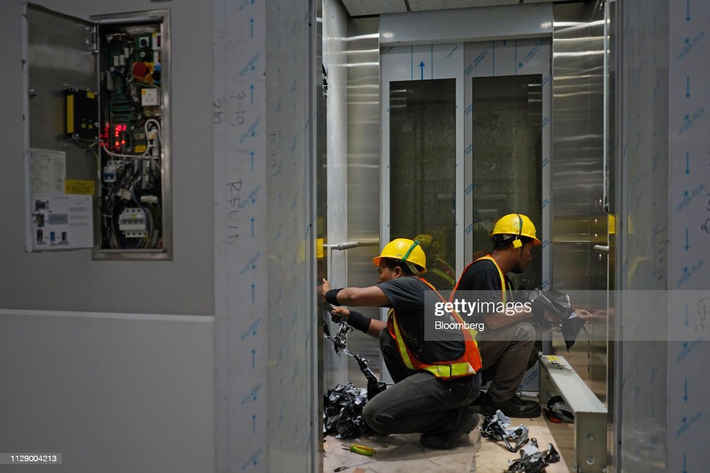 Workers Install An Elevator At The Under Construction Jakarta Mass