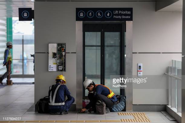 Workers install an lift at the under construction Jakarta Mass Rapid Transit in Jakarta Indonesia on February 18 2019 Indonesia's first mass rapid...