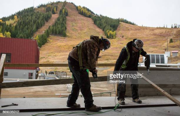 Workers install material at the Josie Hotel under construction at the Red Mountain ski resort in Rossland British Columbia Canada on Wednesday Oct 18...