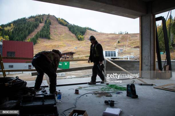 Workers install material inside the Josie Hotel under construction at the Red Mountain ski resort in Rossland British Columbia Canada on Wednesday...