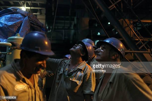 Workers install parts inside the Jose de Alencar vessel a Petroleo Brasileiro SA oil tanker under construction at the Maua SA shipyard in Niteroi...