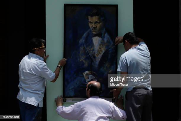 Workers install portraits of Jose Luis Cuevas before an homage to Mexican artist at Jose Luis Cuevas Museum on July 04 2017 in Mexico City Mexico...