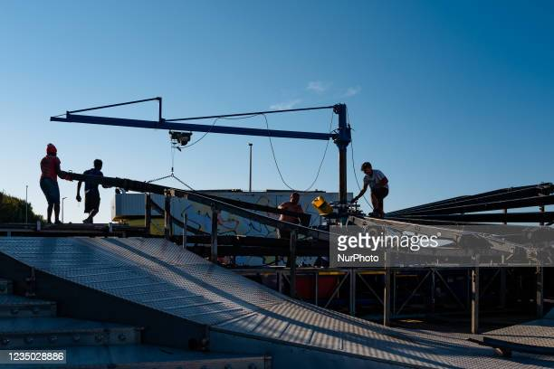 Workers install the carousel at the Luna Park at Secca dei Pali in Molfetta, on 2 September 2021. On the occasion of the patronal feast of Our Lady...
