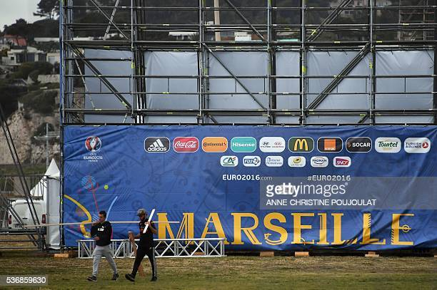 Workers install the fanzone site for the UEFA Euro 2016 on the Prado beaches in Marseille where supporters will gather to watch the games on June 1...