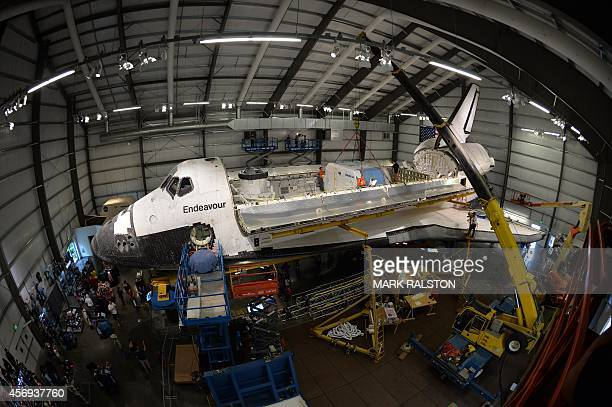 Workers install the final payload a configuration similar to the STS118 mission consisting of a flown SPACEHAB into the Space Shuttle Endeavour which...
