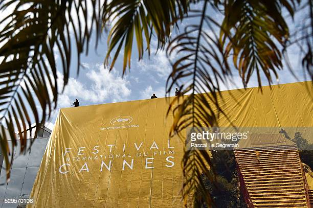 Workers install the official Poster of the 69th Cannes Film Festival on May 09 2016 in Cannes France