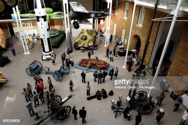 Workers install Turner Prize winning artist Jeremy Dellers work titled Baghdad 5 March 2007 at the Imperial War Museum London The museums new...