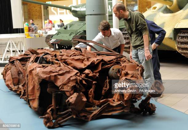 Workers install Turner Prize winning artist Jeremy Deller's work titled Baghdad 5 March 2007 at the Imperial War Museum London The museum's new...