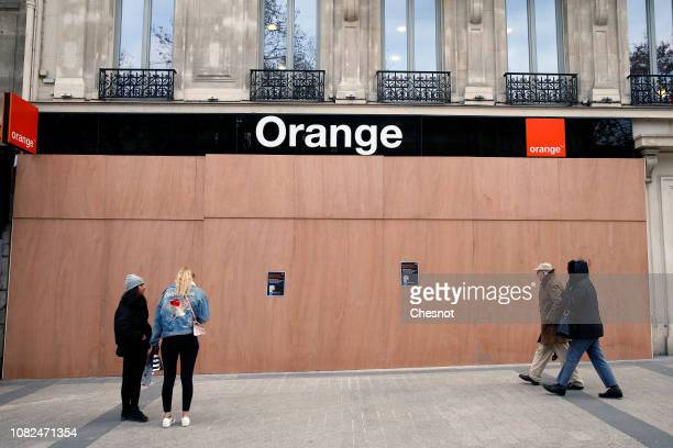 Workers install wood panels to protect the facade of the French telecommunications company Orange against possible damage on the eve of a...