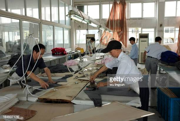 Workers ironing sweaters in China's sweater factory.