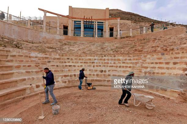 Workers keep flat the restored floor of the ancient theatre built by Herod the Great between 23-15 BCE in the Judaean desert, southeast of Bethlehem...