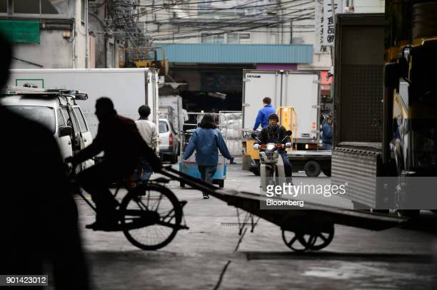 Workers labor after the first auction of the year at Tsukiji Market in Tokyo Japan on Friday Jan 5 2018 Tokyo's iconic Tsukiji fish market held its...