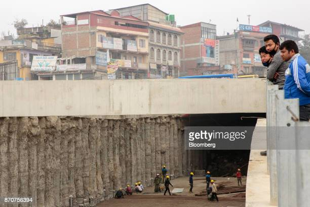 Workers labor at a construction site for an underpass operated by Shanghai Construction Group Co in the Kalanki Chowk area of Kathmandu Nepal on...