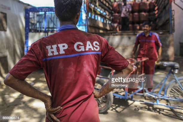 Workers labor at a Hindustan Petroleum Corp liquefied petroleum gas depot in Mumbai India on Saturday April 8 2017 Expanding fuel shipments from the...
