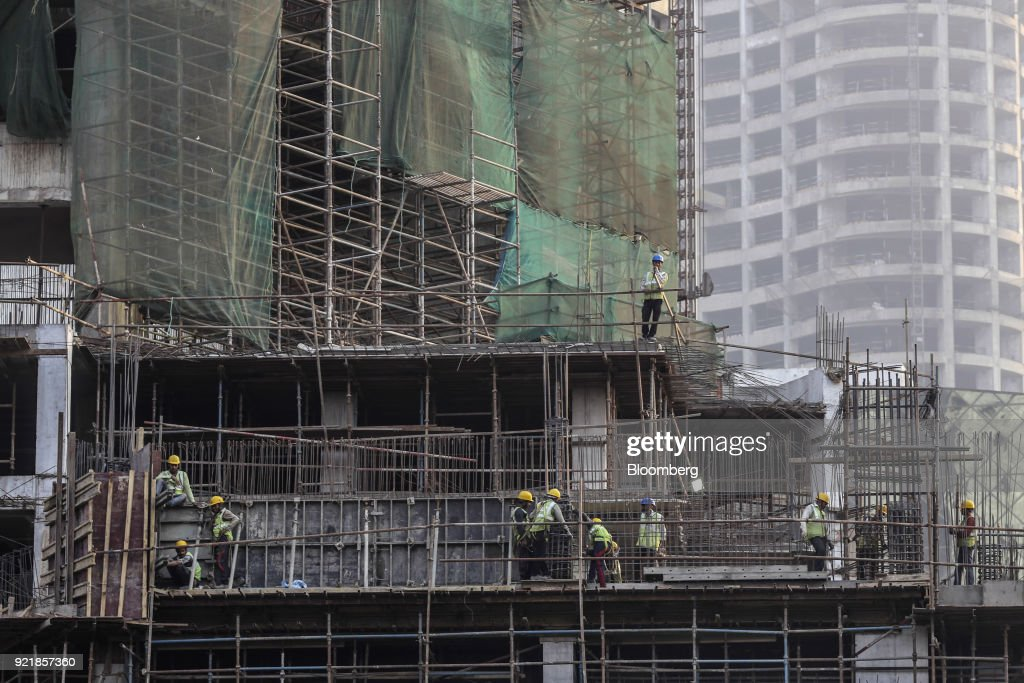 Workers labor at the construction site for Trump Tower Mumbai at Lodha The Park, a luxury residential project developed by Lodha Developers Ltd., in Mumbai, India, on Tuesday, Feb. 20, 2018. India has the most construction projects with Trump licensing deals of any country outside of the U.S. Photographer: Dhiraj Singh/Bloomberg via Getty Images
