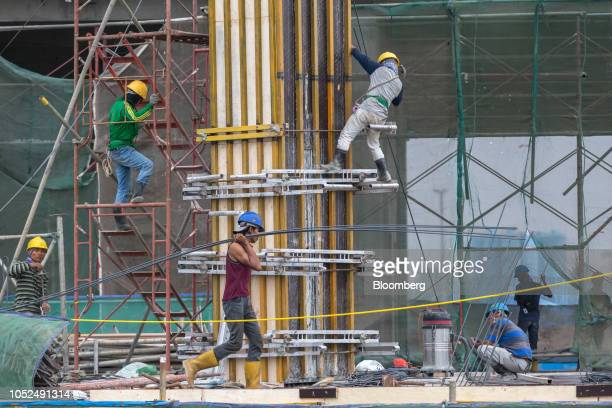 Workers labor at the under construction Meikarta project developed by Lippo Group in Bekasi Regency West Java Province Indonesia on Thursday Oct 18...