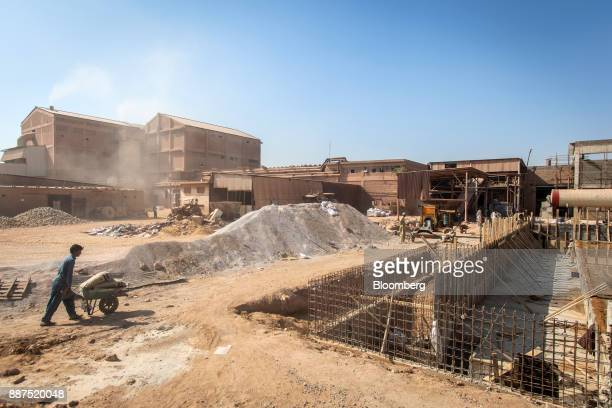 Workers labor in a construction site for new facilities at the Shabbir Tiles Ceramics Ltd production facility in Karachi Pakistan on Wednesday Dec 6...