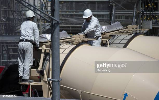 Workers labor on a concrete mixer truck at the construction site of the New National Stadium a venue for 2020 Summer Olympics and Paralympics in...