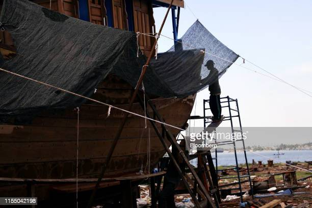 Workers labor on a fishing boat at a shipbuilding company in Quang Nam province Vietnam on Wednesday June 26 2019 Fishermen are on the front lines of...