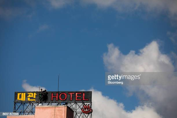 Workers labor on a hotel sign in Hoenggye-ri village area of Pyeongchang, Gangwon, South Korea, on Friday, Oct. 20, 2017. With less than 100 days to...
