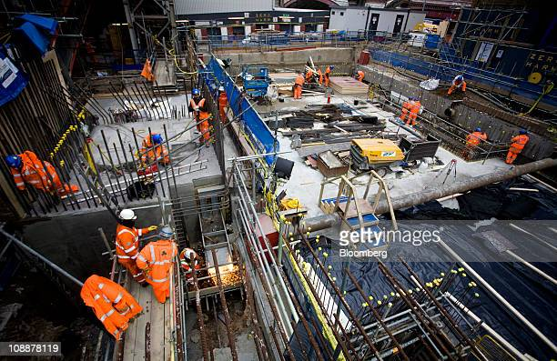 Workers labor on the Balfour Beatty construction site at the Blackfriars Bridge station development in London UK on Friday Feb 4 2011 Balfour Beatty...