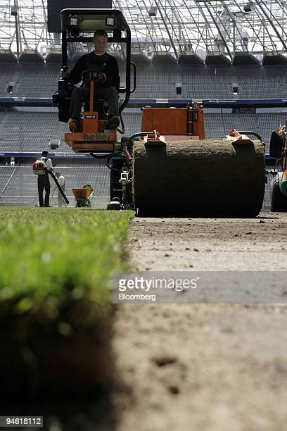 Workers lay new turf in the Munich Allianz Arena in Munich Germany on Wednesday May 17 2006 Workers laid new grass before the start of the 2006 World...