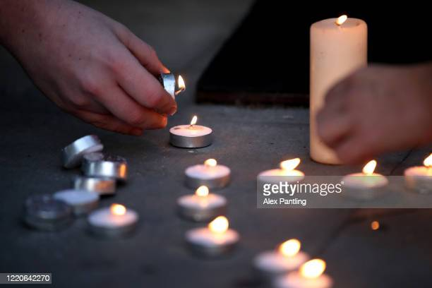 Workers lays down candles in memory of a colleague at Newham University Hospital on April 23, 2020 in London, United Kingdom. Following the success...