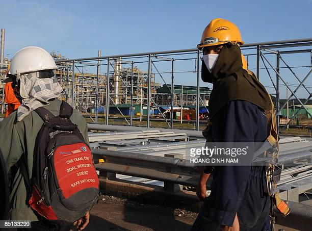 Workers leave after their working hours the Dung Quat oil refinery on February 21 2009 in the central province of Quang Ngai Vietnam's young and...