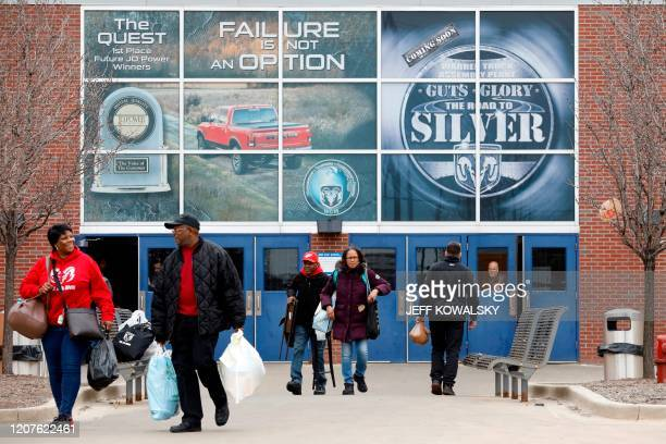 Workers leave FCA Chrysler Warren Truck Assembly after the Detroit three automakers have agreed to UAW demands to shut down all North America plants...