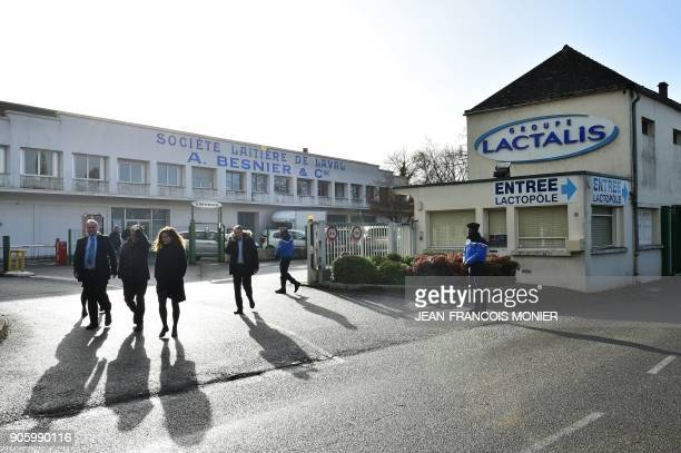 Workers leave the Lactalis Group headquarters in Laval northwestern France on January 17 2018 French police raided the headquarters of dairy giant...