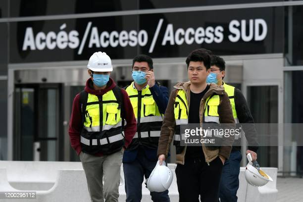 Workers leave the Mobile World Congress MWC venue on February 12 2020 at the Fira Barcelona Montjuic centre in Barcelona Organisers of the World...